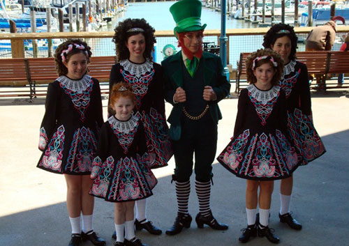 Bay Music and Entertainment performer https://www.baymusic.com/wp-content/uploads/legacy/images/leprechaun and lasses.jpg